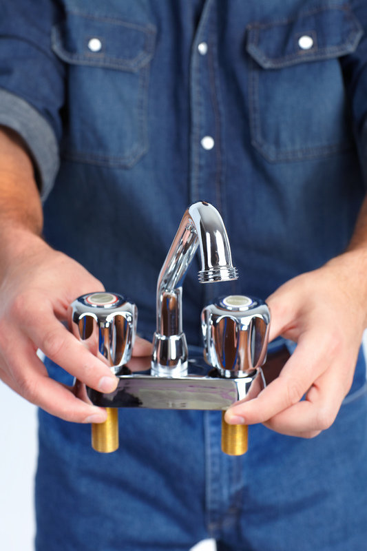 plumbing experts of West Palm Beach with faucet